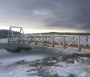 A pontoon getting lifted from the lake for repairs and repositioning