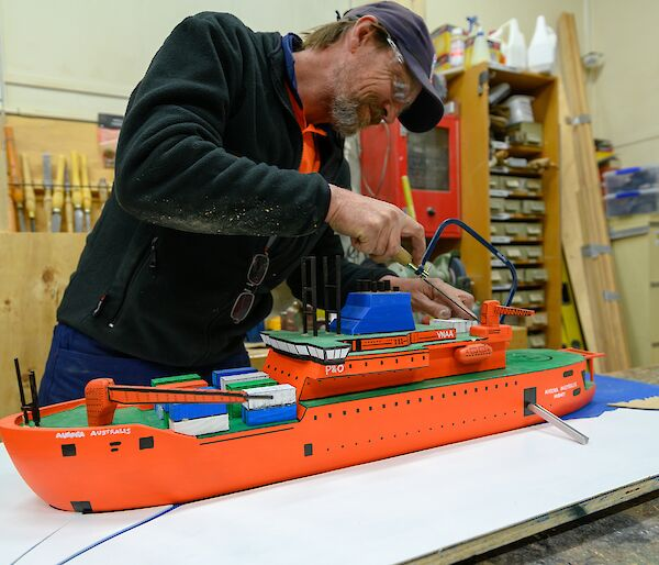 Grant in the process of building a scale model of the Aurora Australis ship in the Davis workshop