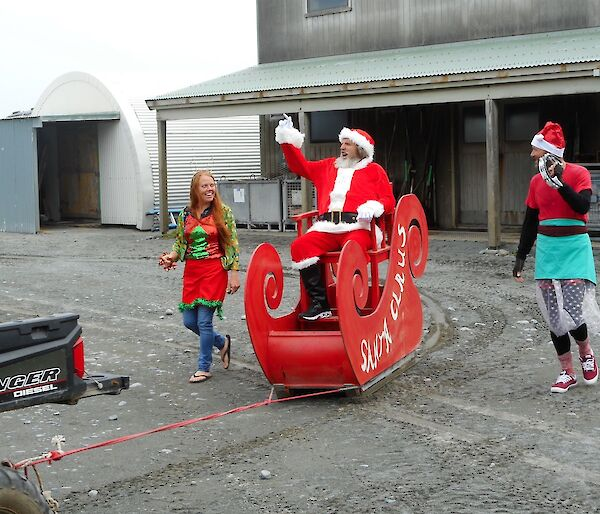 Santa arrives on Christmas day at Macqurie Island station in a sleigh
