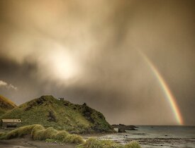 storm cloud and rainbow