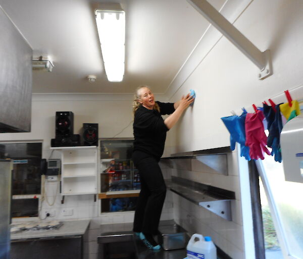 Chef cleaning kitchen walls