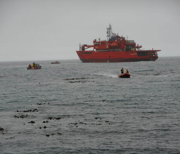 Two watercraft heading ashore from the icebreaker ship