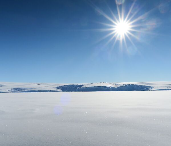 Landscape of the sun over the sea ice and ice cliffs
