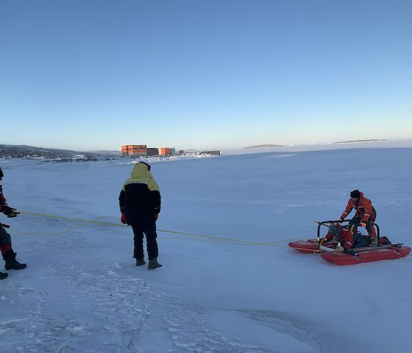 Three expeditioners undertaking a search and rescue exercise