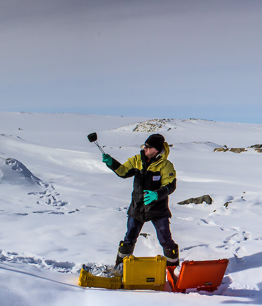 Panorama view of scientist on the ice using equipment to gather air samples and air data