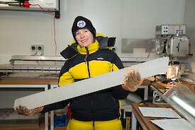 A scientist holds an ice core.