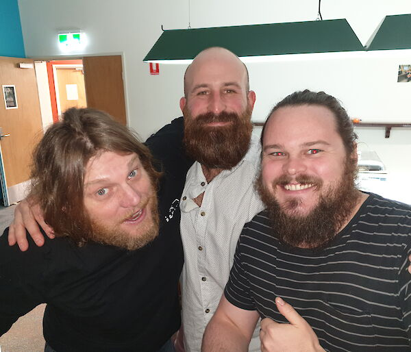 Three expeditioners showing off their beards
