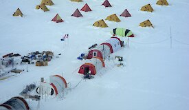 Rows of tents at an ice core drill camp in Anarctica.