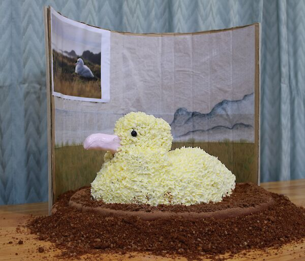 a cake made to resemble an albatross on a nest