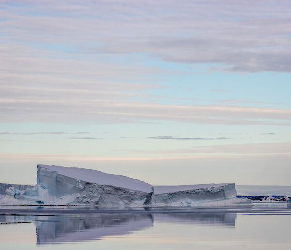 Icebergs being reflected in the water on a still day