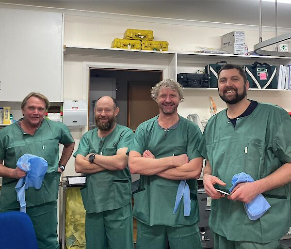 Four lay surgical assistants in training in theatre